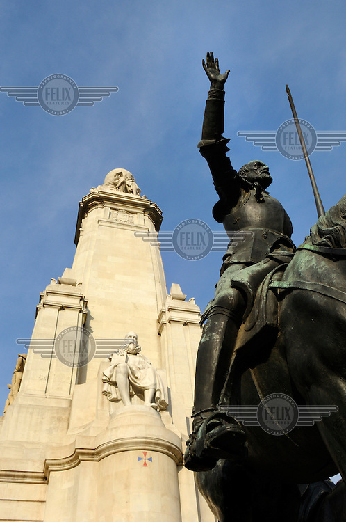 A statue of Don Quixote at the base of the monument to Cervantes in the Plaza de Espana.