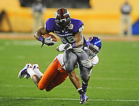 Jan. 4, 2010; Glendale, AZ, USA; TCU Horned Frogs wide receiver (88) Jimmy Young is tackled by Boise State Broncos safety (8) George Iloka in the 2010 Fiesta Bowl at University of Phoenix Stadium. Boise State defeated TCU 17-10. Mandatory Credit: Mark J. Rebilas-