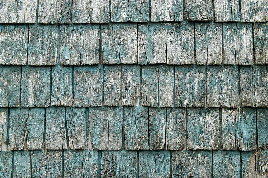 Weathered wooden shingle detail.
