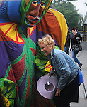 A festival attender reacts to the Arm-of-the-Sea Theater's  parade through the festival grounds, at the 27th Annual Hudson Valley Garlic Festival, held in Cantine Memorial Field, in Saugerties, NY, on Saturday, October 1, 2016. Photo by Jim Peppler; Copyright Jim Peppler 2016.