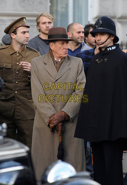 """GEOFFREY RUSH .On the set of """"The King's Speech"""" filming in central London, England, UK, November 21st 2009..filmset film movie on location half length brown hat coat  leather gloves profile .CAP/IA.©Ian Allis/Capital Pictures"""