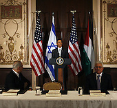 New York, NY - September 22, 2009 -- United States President Barack Obama speaks at a trilateral meeting with Israeli Prime Minister Benjamin Netanyahu (L) and Palestinian President Mahmoud Abbas (R) at the Waldorf Astoria Hotel in New York City on Tuesday, September 22, 2009.    .Credit: John Angelillo / Pool via CNP