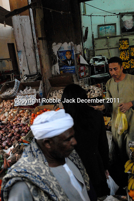 Man selling fruit and vegatables in the Sharia Souk in Luxor.The town of Luxor occupies the eastern part of a great city of antiquity which the ancient Egytians called Waset and the Greeks named Thebes.