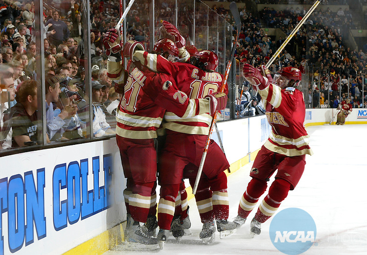 10 APR 2004:  Denver University celebrates the only goal of the game by forward Gabe Gauthier (9) against the University of Maine during the Division I Men's Ice Hockey Championship held at the Fleet Center in Boston, MA.  Denver defeated Maine 1-0 for the national title.  Jamie Schwaberow/NCAA Photos