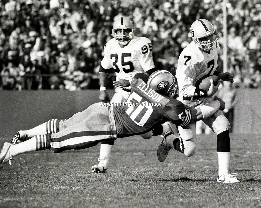 Los Angeles Raider quarterback Steve Beuerlein is .hit by San Francisco linebacker Riki Ellison. #35 is Raider Running back Steve Smith ( 1988 photo by Ron Riesterer)