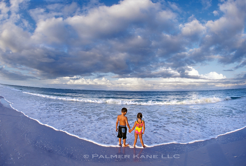 Children watching the horizon for distant approaching storm clouds