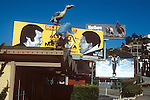 Billboards on the Sunset Strip featuring Herb Alpert, Hugh Masekele, Warren Beatty and the Marlboro Cowboy circa 1978