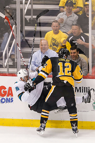 June 1, 2016:  Pittsburgh Penguins defenseman Ben Lovejoy (12) checks San Jose Sharks center Tomas Hertl (48) to the ice during the San Jose Sharks and Pittsburgh Penguins NHL Stanley Cup playoff game at Consol Energy Center in Pittsburgh, PA. Pittsburgh beat San Jose in overtime, 2-1.