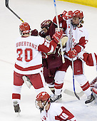 Dan Bertram 22 of Boston College battles with Kyle Klubertanz 20 and Joe Piskula 7 of the University of Wisconsin. The Boston College Eagles defeated the University of Wisconsin Badgers 3-0 on Friday, October 27, 2006, at the Kohl Center in Madison, Wisconsin in their first meeting since the 2006 Frozen Four Final which Wisconsin won 2-1 to take the national championship.<br />