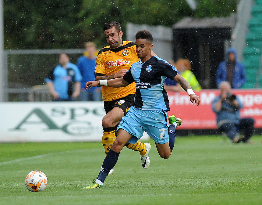 Wycombe Wanderers' Paris Cowan-Hall is fouled by Newport County's Andy Sandell<br /> <br /> Photographer Ashley Crowden/CameraSport<br /> <br /> Football - The Football League Sky Bet League Two - Newport County AFC v Wycombe Wanderers - Saturday 9th August 2014 - Rodney Parade - Newport<br /> <br /> &copy; CameraSport - 43 Linden Ave. Countesthorpe. Leicester. England. LE8 5PG - Tel: +44 (0) 116 277 4147 - admin@camerasport.com - www.camerasport.com