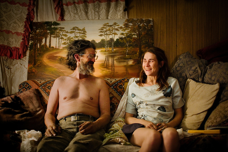 """""""American Gothic Redux""""..Tumbleweed (his only name given) sits on the couch with his best friend?s wife, Moria Morofsky, in the Morofsky?s trailer. Weeds, as he likes to be called by his friends, visits the couple daily to watch movies and smoke pot. He says of Moria, ?If Ben had not married her, I surely would have.? The coment generated an uncomfortable laugh from Moriah. ."""