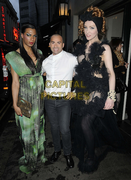 Louie Spence ( centre ) & models.The 3rd annual Interlaw Diversity Forum Spring Carnival in aid of the Albert Kennedy Trust, The Ivy Club, West St., London, England..April 22nd, 2012.full length white shirt jeans denim green black dress print  chiffon tulle.CAP/CAN.©Can Nguyen/Capital Pictures.
