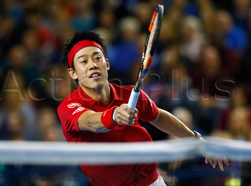 06.03.2016. Barclaycard Arena, Birmingham, England. Davis Cup Tennis World Group First Round. Great Britain versus Japan. Japan's Kei Nishikori volleys during his singles match against Great Britain's Andy Murray on day 3 of the tie.