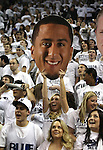 Nevada junior Carolann Cavallo shows support for the San Francisco 49ers quarterback Colin Kaepernick during the NCAA men's basketball game between San Diego State and Nevada, on Wednesday, Jan. 23, 2013 in Reno, Nev. Kaepernick graduated from Nevada in 2011. (AP Photo/Cathleen Allison)
