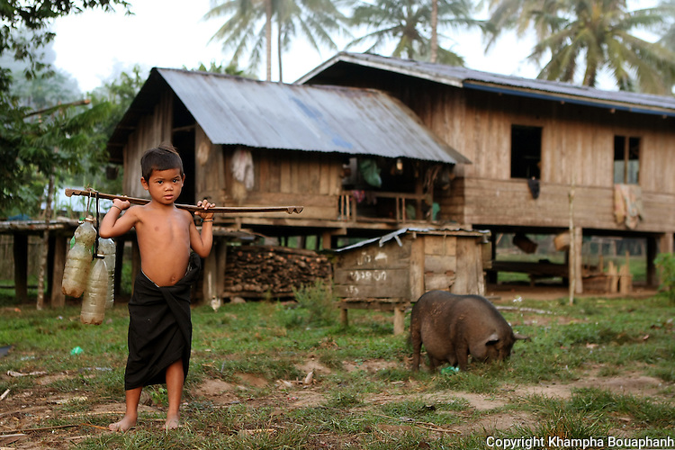 Ban Xan Gowl, Savannahket Province, Laos, November 10, 2012. (Photo by Khampha Bouaphanh)