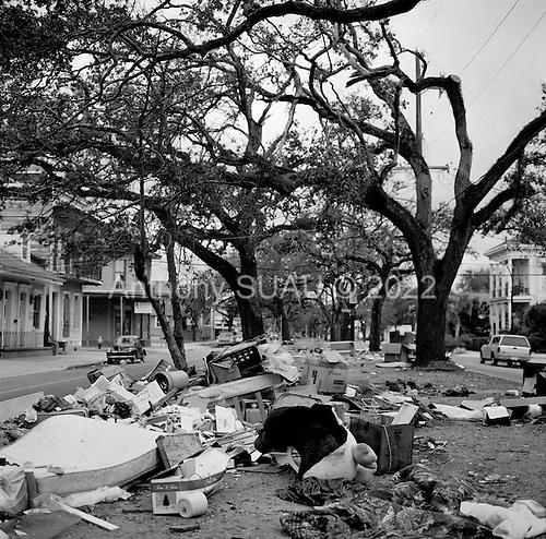 New Orleans, Louisiana.USA.December 4, 2005 ..Scenes in the aftermath and recovery of hurricane Katrina. Streets of New Orleans are flooded with garbage after people gut their homes and dump the waste on to the street.