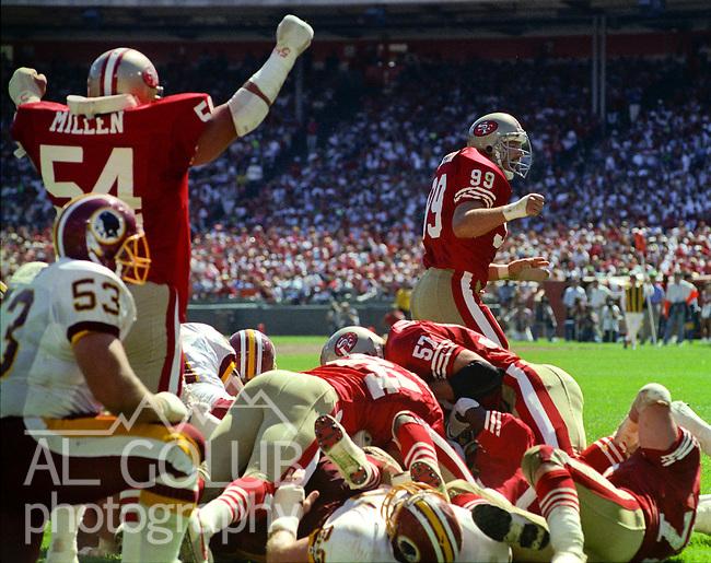 San Francisco 49ers vs Washington Redskins at Candlestick Park Sunday, September 16, 1990..49ers beat Redskins 26-13.49er linebacker Matt Millen (54) and linebacker Mike Walters (99) celebrate stoping Redskins drive...