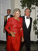 Associate Justice of the Supreme Court Sandra Day O'Connor, left, and her husband, John J. O'Connor, III, arrive at the White House in Washington, DC for the State Dinner in honor of President Carlos Salinas de Gortari of Mexico, hosted by United States President George H.W. Bush and first lady Barbara Bush on October 3, 1989.<br /> Credit: Ron Sachs / CNP
