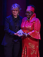 Washington, DC - June 17, 2014: Tanzanian entrepreneur Dr. Victoria Kisyombe (r) receives the Economic Empowerment Award from Anne Finucane, chief Strategy and Marketing officer at Bank of America, during the Vital Voices Global Leadership Awards at the John F. Kennedy Center in the District of Columbia, June 17, 2014. Dr. Kisyombe received the award for her work in redesigning the traditional model of micro-financing to help Tanzanian women gain business opportunities. (Photo by Don Baxter/Media Images International)
