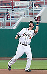 Reno Aces thrid baseman Taylor Harbin makes the play on a popup against the Sacramento River Cats during their game on Monday night July 30, 2012 at Aces Ballpark in Reno, Nevada.