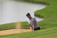 Danny Willett (ENG) chips from a bunker at the 9th green during Sunday's Final Round of the 2014 BMW Masters held at Lake Malaren, Shanghai, China. 2nd November 2014.<br /> Picture: Eoin Clarke www.golffile.ie