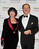 Chita Rivera, one of the 2002 Kennedy Center honorees, arrives with Mr. Nehaus for the formal Artist's Dinner at the United States Department of State in Washington, D.C. on Saturday, December 4, 2010..Credit: Ron Sachs / CNP.
