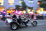 Three women ride a motorcyle trike during the 2009 Sydney Gay and Lesbian Mardi Gras Parade.