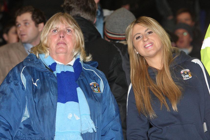 Coventry City's Fans<br /> <br /> Photo by Kieran Galvin/CameraSport<br /> <br /> Football - The Football League Sky Bet League One - Leyton Orient v Coventry City - Tuesday 28th Januray 2014 - Matchroom Stadium - London<br /> <br /> &copy; CameraSport - 43 Linden Ave. Countesthorpe. Leicester. England. LE8 5PG - Tel: +44 (0) 116 277 4147 - admin@camerasport.com - www.camerasport.com