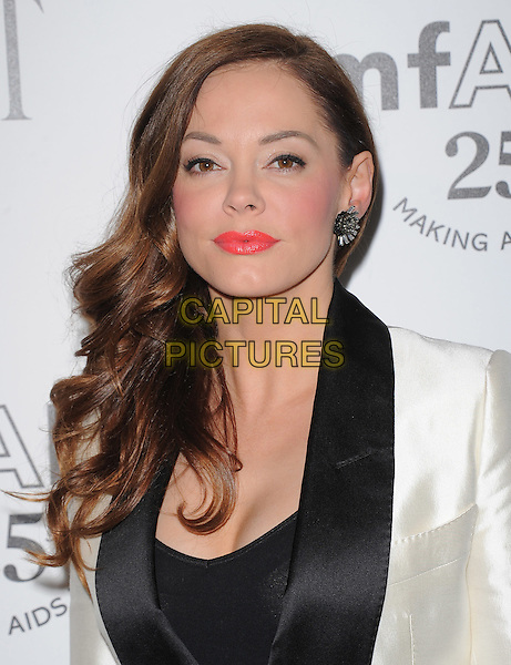 Rose McGowan.The amfAR's Inspiration L.A. Gala held at The Chateau Marmont in Hollywood, California, USA..October 27th, 2011.headshot portrait black white silk satin lapel pink lipstick .CAP/RKE/DVS.©DVS/RockinExposures/Capital Pictures.