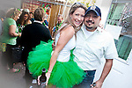 Stacey Page of Tutu's & Hi-Top's, shows off her husband and her St. Patrick's Day  tutu.