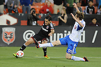 Washington D.C. - May 17, 2014:  Fabian Espindola (9) of D.C. United goes against Wandrille Lefevre (55) of Montreal Impact.  D.C. United tied the Montreal Impact 1-1 during a Major League Soccer match for the 2014 season at RFK Stadium.