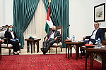 Palestinian President Mahmoud Abbas, meets with minister of Health Mai Alkila, in the West Bank city of Ramallah on May 12, 2020. Photo by Thaer Ganaim