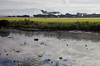Guanabara bay pollution, garbage and fetid mud beside Rio de Janeiro International airport located in the shore of Guanabara Bay.