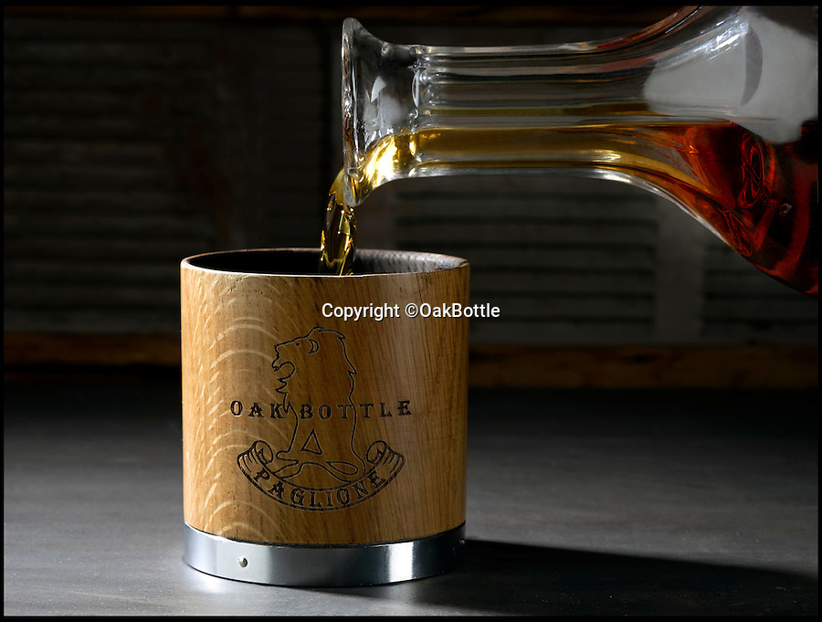 BNPS.co.uk (01202 558833)<br /> Pic: OakBottle/BNPS<br /> <br /> Alcholic alchemy - Cunning invention turns moonshine into a smooth Scotch. <br /> <br /> Inventor claims cheap brandy, rum, red wine and whisky can all be smoothed and improved using his charred oak tumbler.<br /> <br /> This wooden cup replicates the oak barrel ageing process of premium brands by using the same technique to infuse drinks with distinguished flavours.<br /> <br /> Distillers age their drinks for decades to create evocative flavours, but this cup's makers claim they can replicate the process in as little as half an hour.