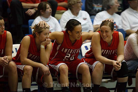 Taylorsville - American Fork's Nikky Ybarra (20) rolls her fingers on her teammates' heads, American Fork's Cydne Mason (3, left) and American Fork's Haley Holmstead (5) watching the final minute from the bench, with a double-digit lead. American Fork vs. Kearns High School girls basketball, 5A State Championship tournament Thursday February 26, 2009 at Salt Lake Community College..