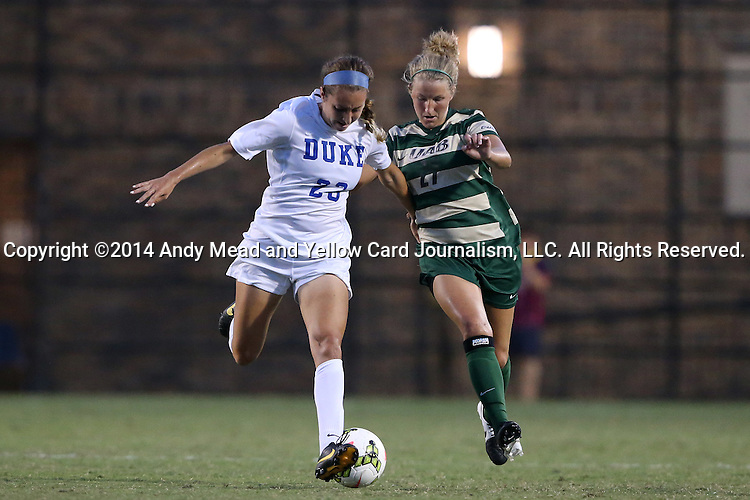 31 August 2014: Duke's Danielle Duhl (23) and UAB's Paige Hanks (21). The Duke University Blue Devils hosted the University of Alabama Birmingham Blazers at Koskinen Stadium in Durham, North Carolina in a 2014 NCAA Division I Women's Soccer match. Duke won the game 3-1.