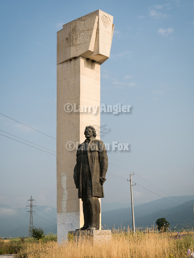 """Monument of Hadji Dimitar on the road to Buzludzha Monument build by the Bulgarian Communist 8n 1981 to commemorate the 1891 organization of the Bulgarian Social Democratic Party which would become the Bulgarian Communist Party. It was abandoned about 1991.<br /> <br /> """"Forget your past, Bulgaria"""""""