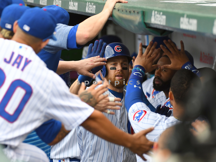 CHICAGO IL - May 21, 2017: Ben Zobrist #18 of the Chicago Cubs during a game against the Milwaukee Brewers on May 21, 2017 at Wrigley Field in Chicago, IL. The Cubs beat the Brewers 13-6.(David Durochik/ SportPics)