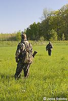 Men hunting wild turkey in a field