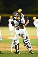 Jacksonville Suns pitcher Frankie Reed (28) celebrates with catcher J.T. Realmuto (11) after closing out game three of the Southern League Championship Series against the Chattanooga Lookouts on September 12, 2014 at Bragan Field in Jacksonville, Florida.  Jacksonville defeated Chattanooga 6-1 to sweep three games to none.  (Mike Janes/Four Seam Images)