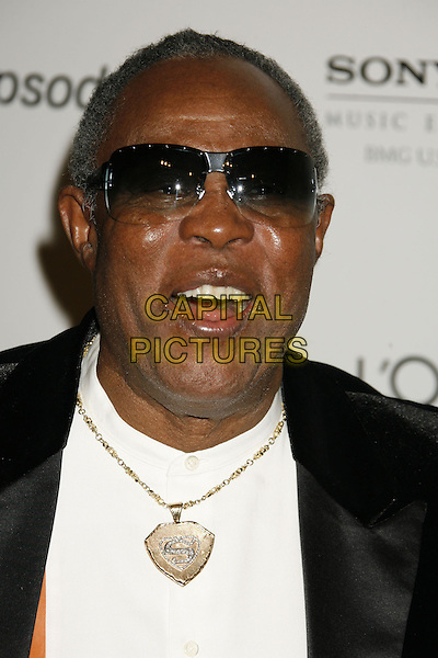SAM MOORE.Clive Davis 2007 Pre-Grammy Awards Party held at the Beverly Hilton Hotel, Beverly Hills, California, USA..February 10th, 2007.headshot portrait sunglasses shades necklace gold mouth open.CAP/ADM/RE.©Russ Elliot/AdMedia/Capital Pictures
