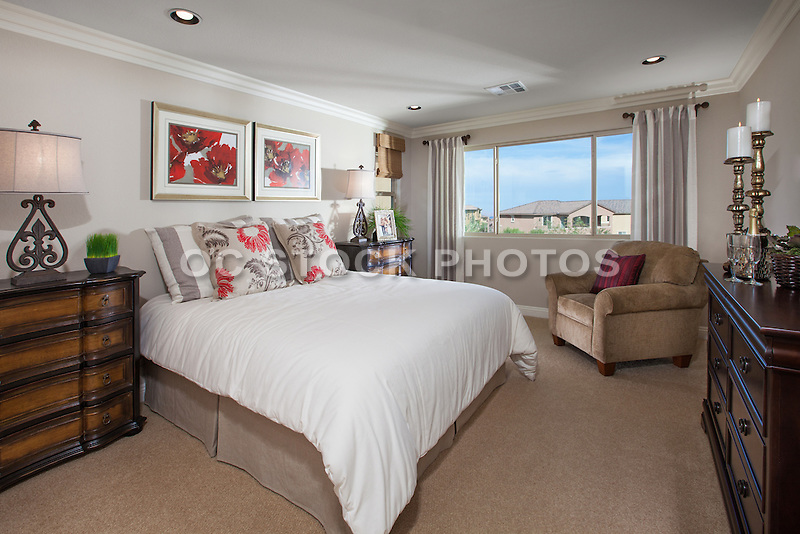 Master Bedroom in Neutral Colors with Red Accents