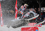 DEADWOOD, SD - FEBRUARY 1, 2013:  Pro Open Racer Justin Broberg of team Hentges Racing flies down the course during practice laps at the the ISOC Amsoil Deadwood Snocross event Friday at the Days of 76 Rodeo Grounds in Deadwood, S.D.   (Photo by Richard Carlson/dakotapress.org)