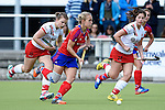 Mannheim, Germany, April 18: During the 1. Bundesliga Damen match between TSV Mannheim (white) and Mannheimer HC (red) on April 18, 2015 at TSV Mannheim in Mannheim, Germany. Final score 1-7 (1-4). (Photo by Dirk Markgraf / www.265-images.com) *** Local caption *** (l-r) Viktoria Przybilla #15 of TSV Mannheim, Lydia Haase #12 of Mannheimer HC, Lea Goerdt #27 of TSV Mannheim