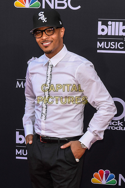 LAS VEGAS, NV - MAY 20: T.I. at the 2018 Billboard Music Awards at the MGM Grand Garden Arena in Las Vegas, Nevada on May 20, 2018. <br /> CAP/MPI/DAM<br /> &copy;DAM/MPI/Capital Pictures