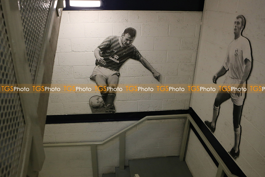 Life size photos of Ex Millwall players,Teddy Sheringham  and Keith Weller adorn the walls by the stairs leading to the Press Box during Millwall vs Scunthorpe United, Sky Bet EFL League 1 Football at The Den on 1st April 2017