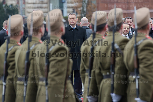 Viktor Orban inspects the guard of honor during a welcoming ceremony in Budapest, Hungary on February 05, 2013. ATTILA VOLGYI