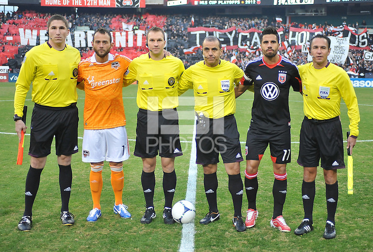 D.C. United captain Marcelo Saragosa with Houston Dynamo Captain Brad Davis with MLS referees at the coin toss. D.C. United tied The Houston Dynamo 1-1 but lost in the overall score 4-2 in the second leg of the Eastern Conference Championship at RFK Stadium, Sunday November 18, 2012.