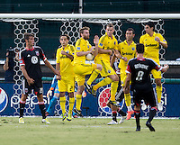 Branko Boskovic (8) of D.C. United has his shot blocked by Eddie Gaven (12) and the wall of the Columbus Crew during the game at RFK Stadium in Washington, DC.  D.C. United defeated the Columbus Crew, 1-0.