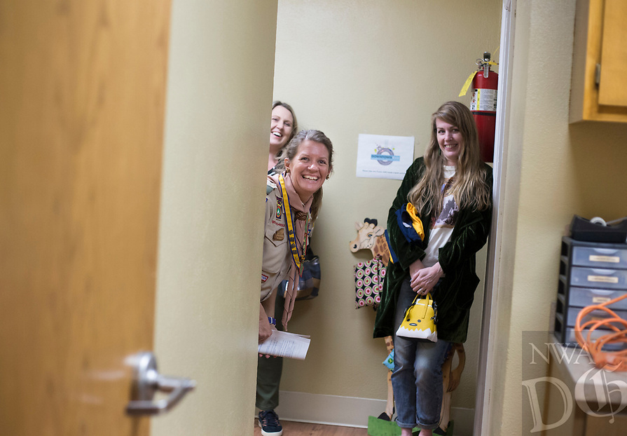 NWA Democrat-Gazette/CHARLIE KAIJO Scout Master Amanda Tyburski (center) and mothers Javene Decker of Rogers and Christine Ahern of Bentonville (from right) react as they watch their daughters bond over a knot tying activity during a family scouting open house, Monday, February 4, 2019 at First United Methodist Church in Bentonville.